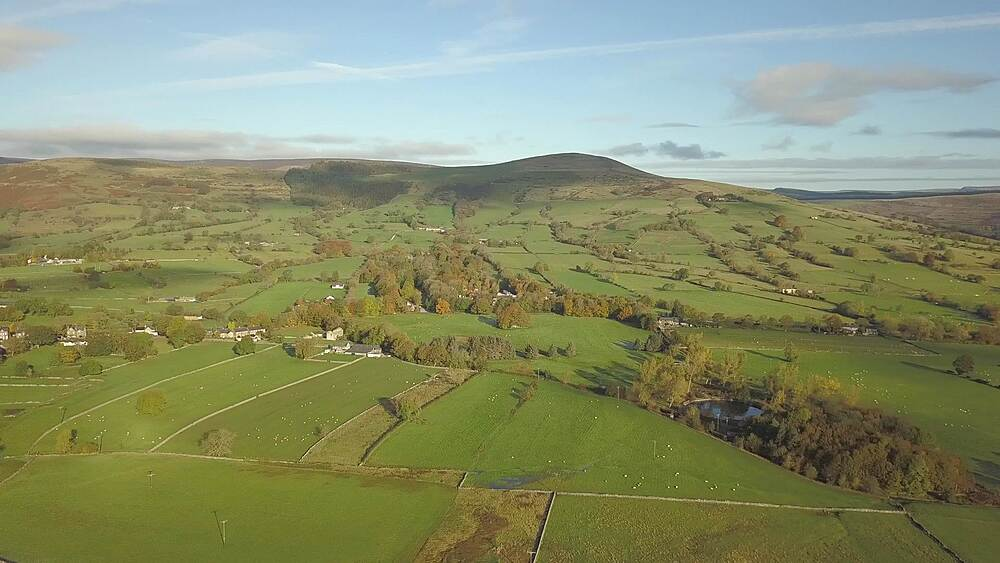Aerial shot over fields from Hope to Castleton in autumn, Hope Valley, Peak District National Park, Derbyshire, England, United Kingdom, Europe