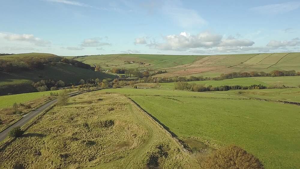 Aerial shot over fields towards Sparrowpit in autumn, Hope Valley, Peak District National Park, Derbyshire, England, United Kingdom, Europe