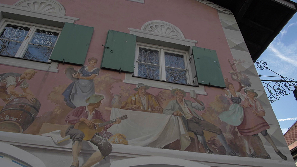 Pan/tilt shot of ornately painted buildings in winter, Garmisch-Partenkirchen, Bavaria, Germany, Europe