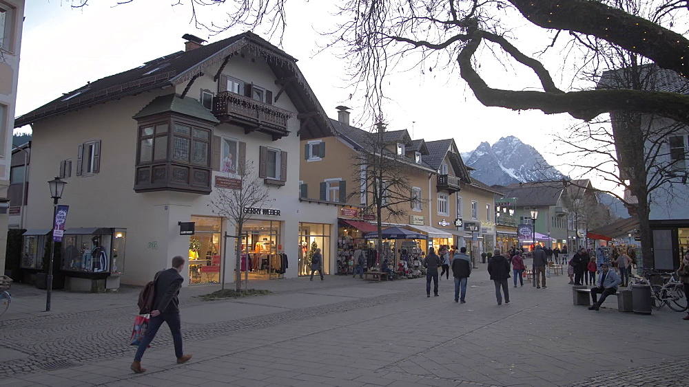Shoppers and Christmas market on Am Kurpark Street, Garmisch-Partenkirchen, Bavaria, Germany, Europe