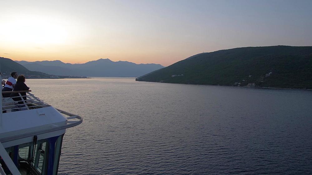 Early morning shot on board cruise ship entering Bay of Kotor, UNESCO World Heritage Site, Montenegro, Europe