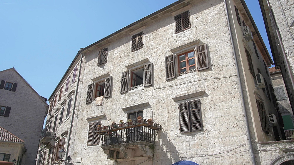 Buildings and cafes in Old Town of Kotor, UNESCO World Heritage Site, Montenegro, Europe