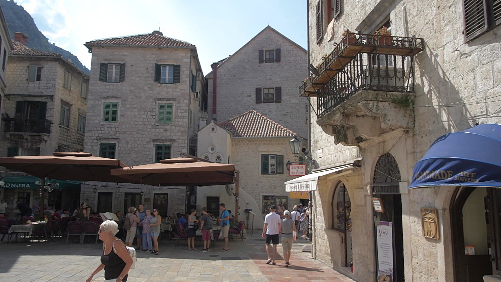 Crane shot of buildings and cafes in Old Town of Kotor, UNESCO World Heritage Site, Montenegro, Europe