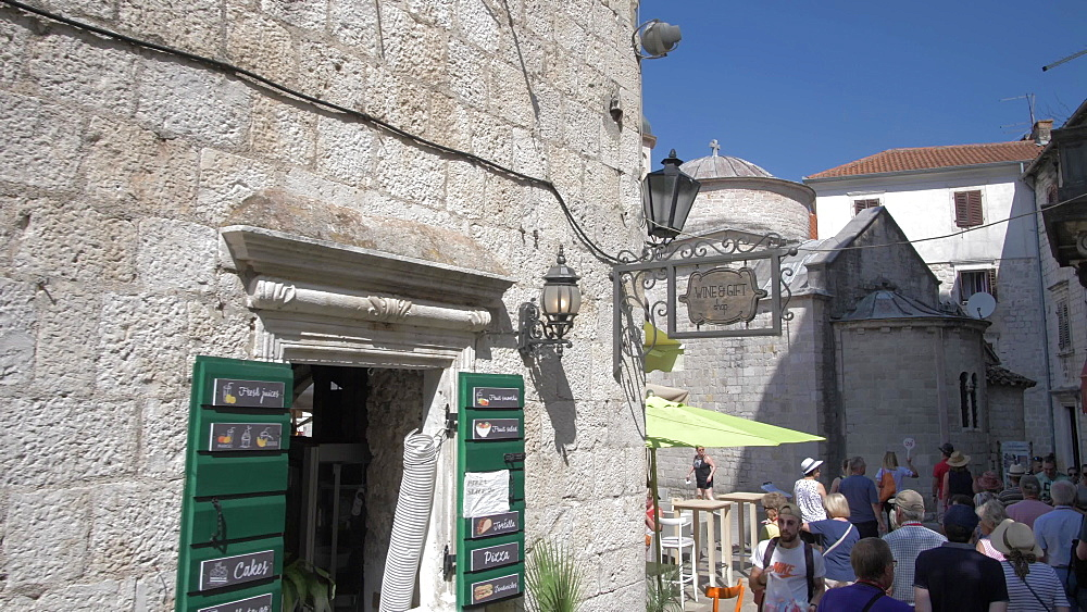 Tourists and St. Nicholas Church in Old Town of Kotor, UNESCO World Heritage Site, Montenegro, Europe
