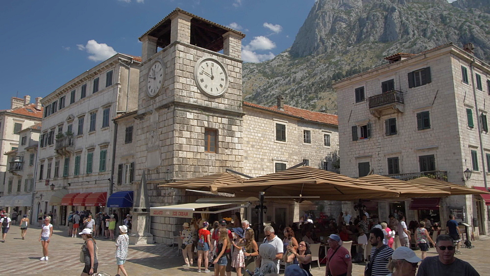 Shops and clock tower in Old Town of Kotor, UNESCO World Heritage Site, Montenegro, Europe