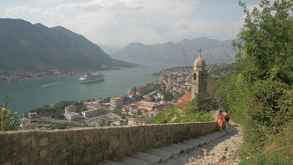 Shot of cruise ship and Chapel of Our Lady of Salvation overlooking the Old Town, Kotor, UNESCO World Heritage Site, Montenegro, Europe