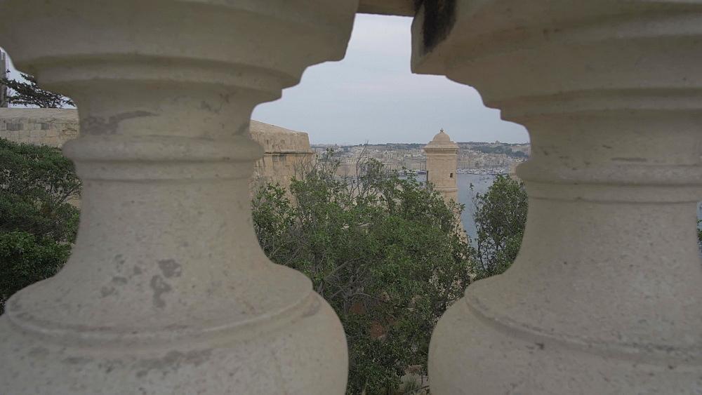 Shot through stone pillars of the Grand Harbour, Valletta, Malta, Mediterranean, Europe