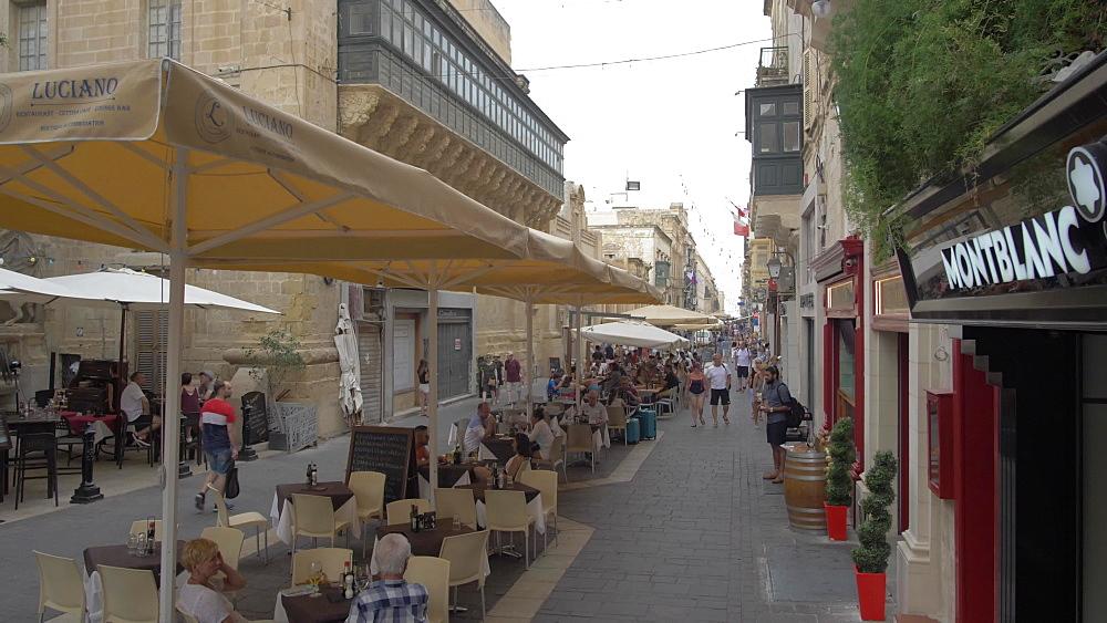 Merchant Street sign and cafes on Merchant Street, Valletta, Malta, Mediterranean, Europe