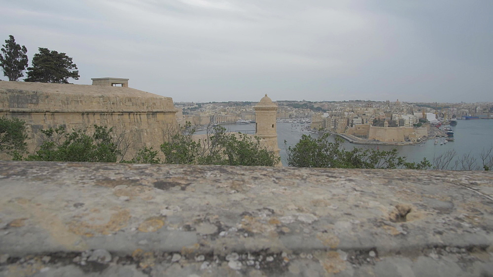 Shot through stone pillars of the Grand Harbour, Valletta, Malta, Mediterranean, Europe