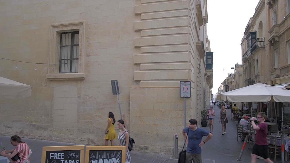 Merchant Street sign and cafes and Merchant Street, Valletta, Malta, Mediterranean, Europe