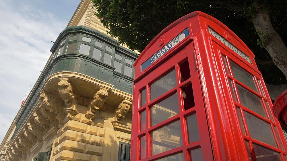Iconic British red post and telephone box on Republic Street, Valletta, Malta, Mediterranean, Europe