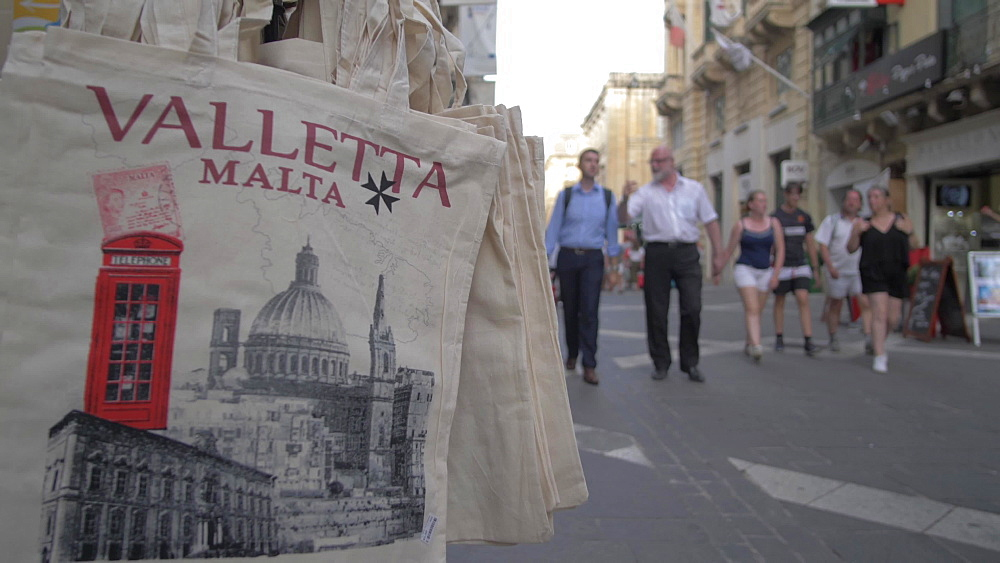 Souvenir bags and people out of focus, Republic Street, Valletta, Malta, Mediterranean, Europe
