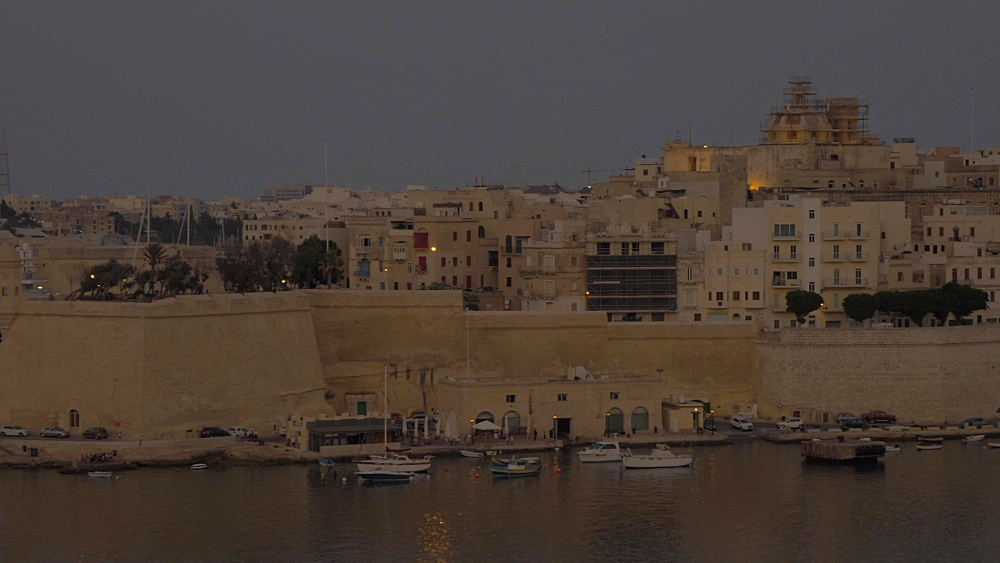 Pan shot of the Grand Harbour at dusk, Valletta, Malta, Europe