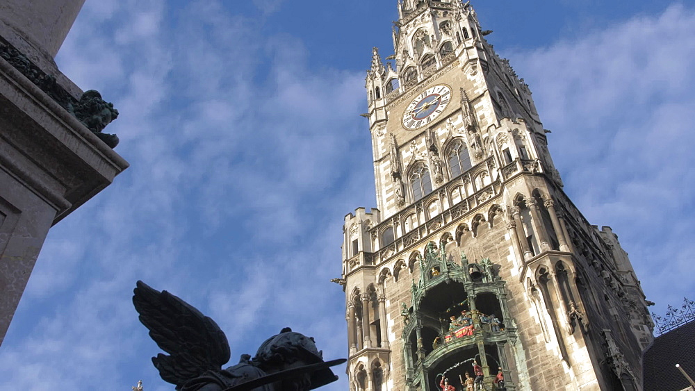 Zoom in shot of Glockenspiel on New Town Hall on sunny day, Munich, Bavaria, Germany, Europe