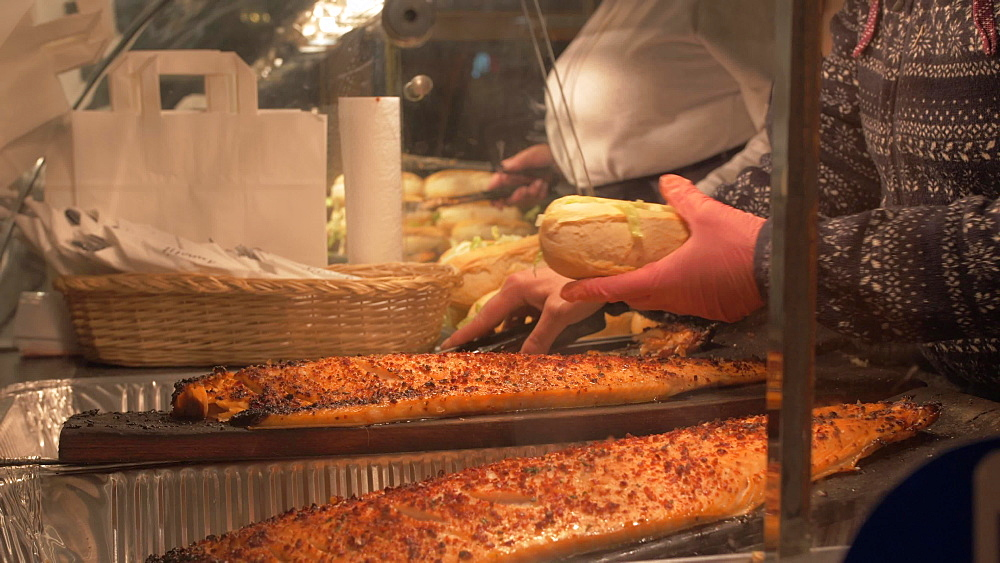 Slider shot of hot food preparations on Christmas Market in Marienplatz at Christmas, Munich, Bavaria, Germany, Europe
