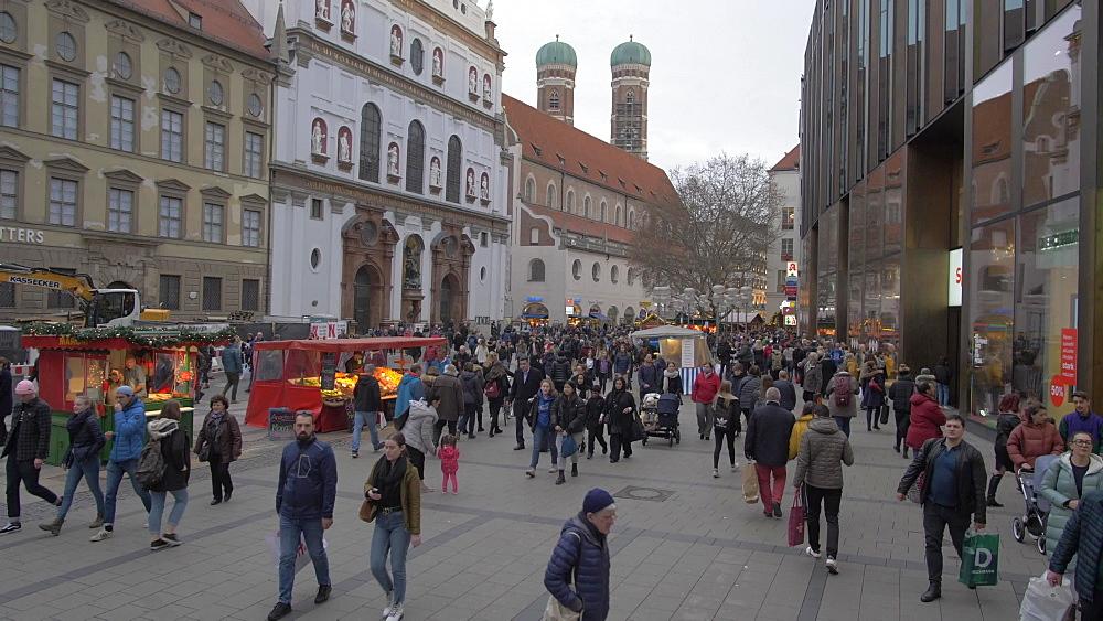 Crane shot of busy shopping scene on Kaufingerstrasse, Munich, Bavaria, Germany, Europe