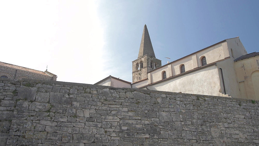 Church and promenade wall of the Old Town of Porec, Istra, Adriatic Sea, Croatia, Europe