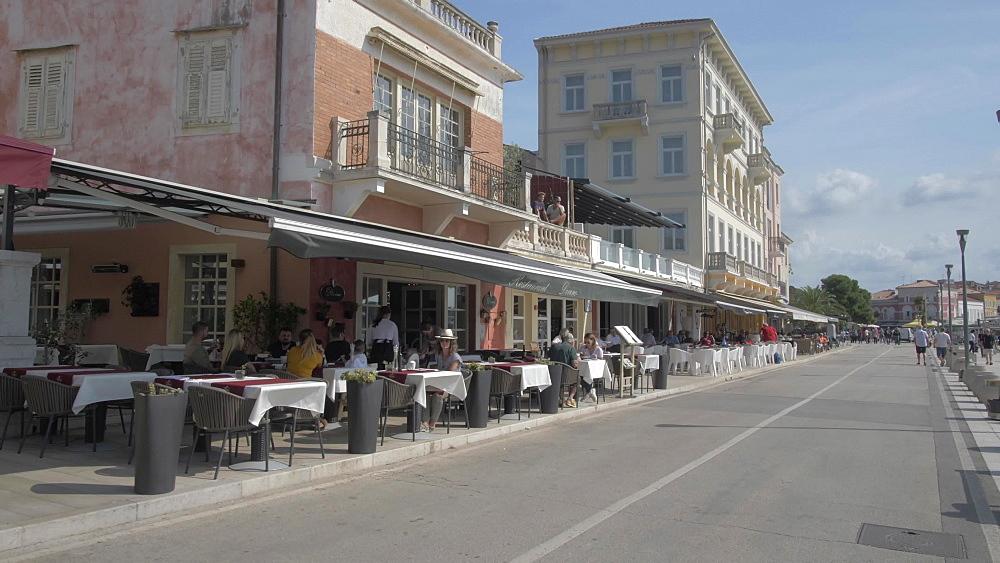 Restaurants and promenade of the Old Town of Porec, Istra, Adriatic Sea, Croatia, Europe