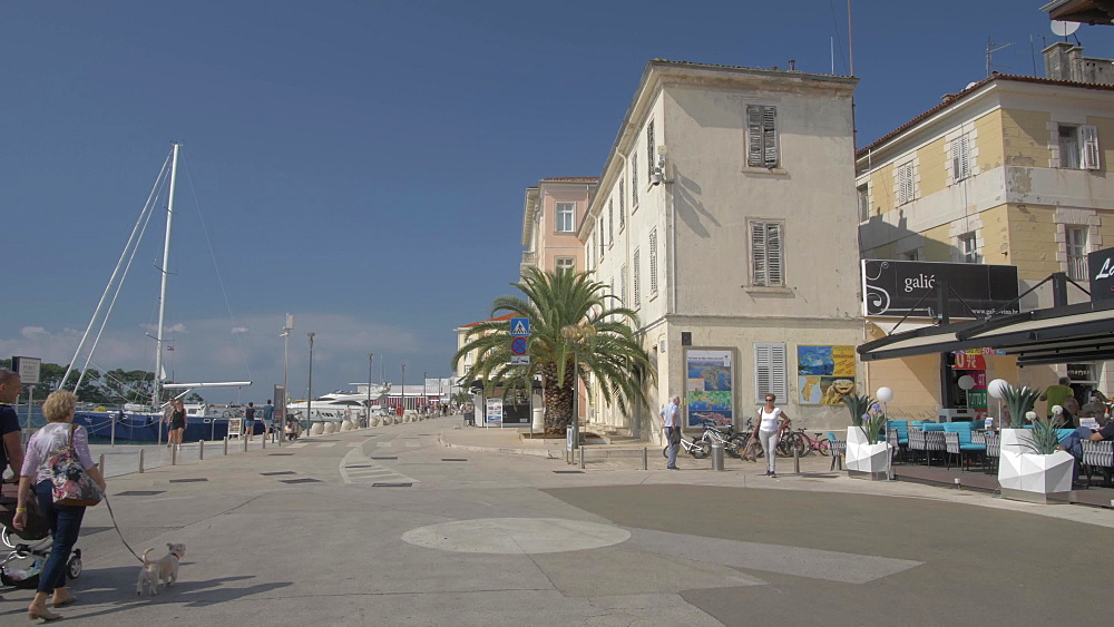 Restaurants and promenade of the Old Town of Porec, Istra, Adriatic Sea, Croatia, Europe