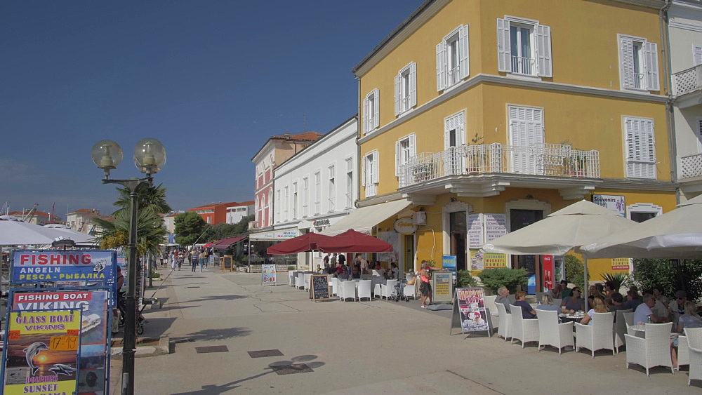 Restaurants and promenade and harbour boats of the Old Town of Porec, Istra, Adriatic Sea, Croatia, Europe