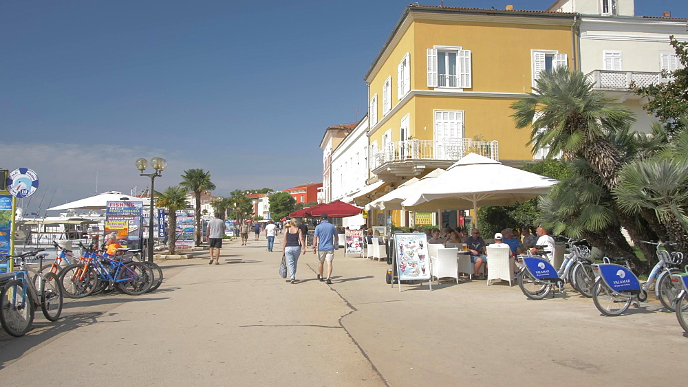 Buildings and promenade at the harbour of Porec, Istra, Adriatic Sea, Croatia, Europe
