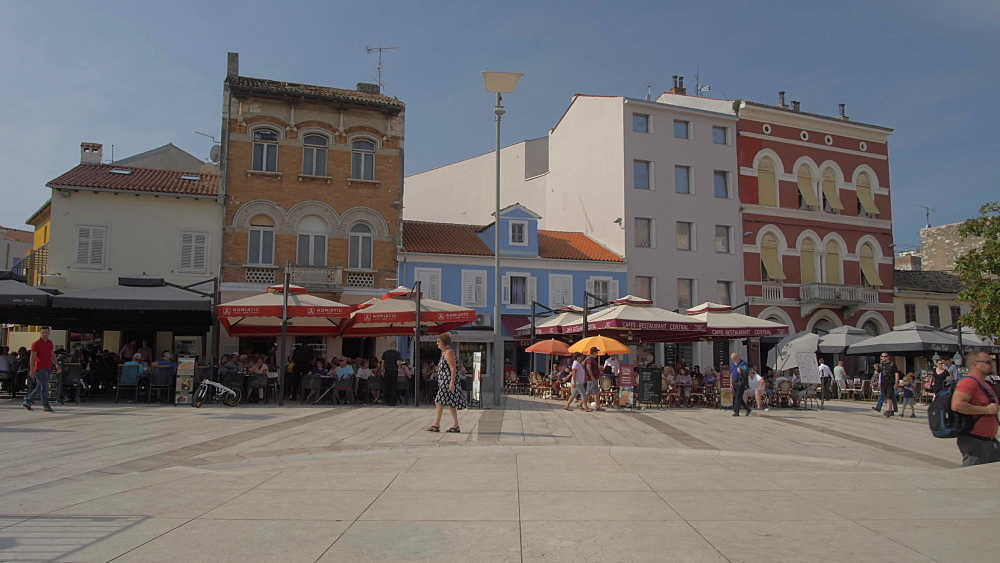 Tracking shot of colourful buildings on Trg Slobode, Porec, Istra, Adriatic Sea, Croatia, Europe