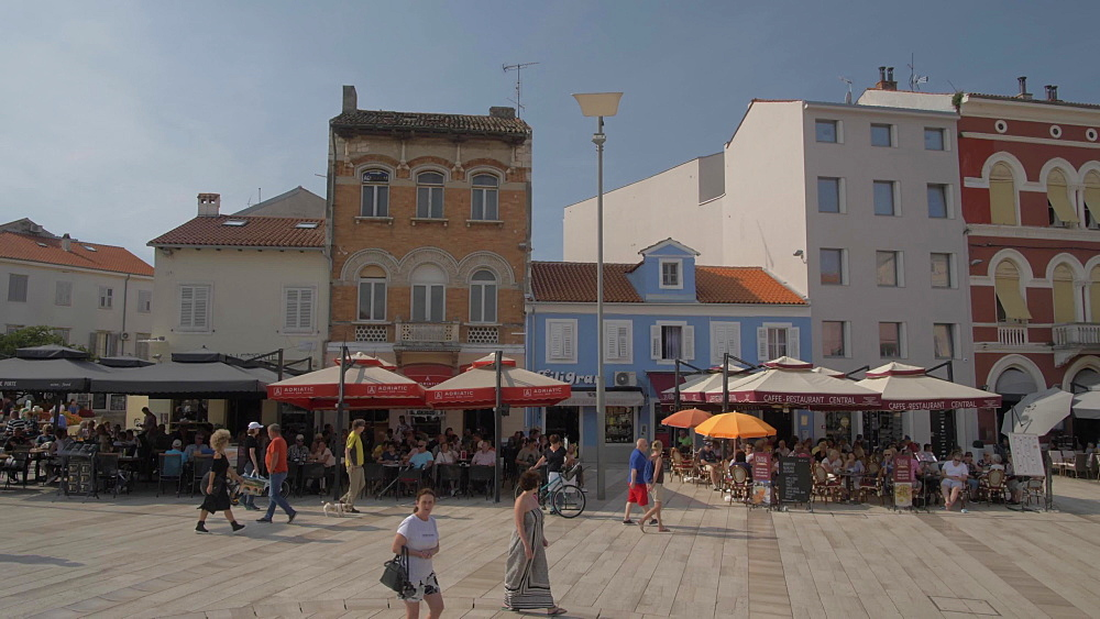 Crane shot of colourful buildings on Trg Slobode, Porec, Istra, Adriatic Sea, Croatia, Europe