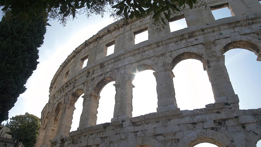 Sun breaking through the Amphitheatre, Pula, Istria County, Croatia, Adriatic, Europe