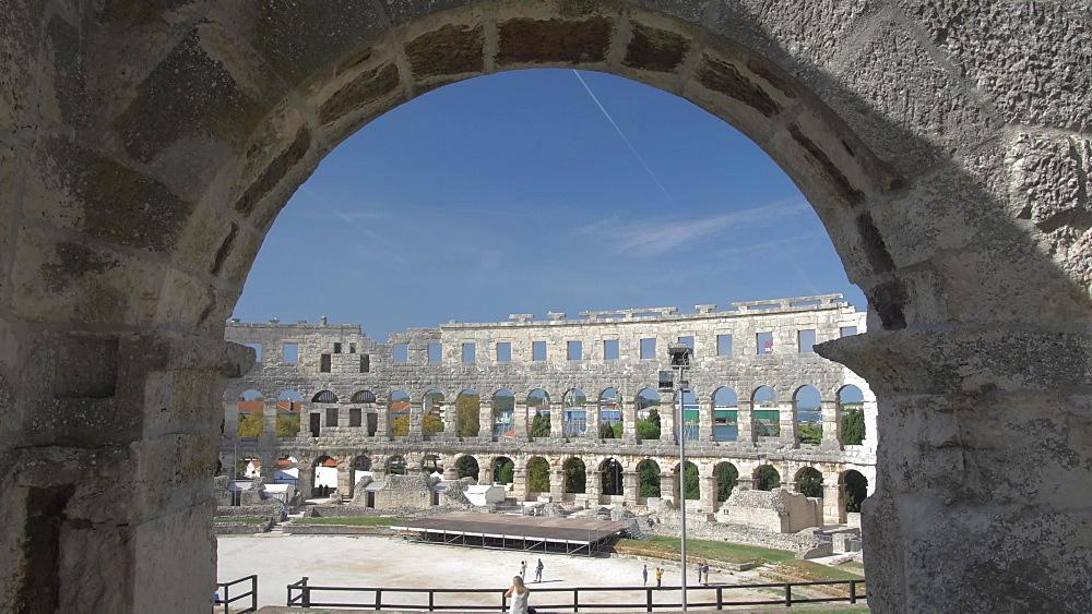 Shot through railings of the Amphitheatre against blue sky, Pula, Istria County, Croatia, Adriatic, Europe
