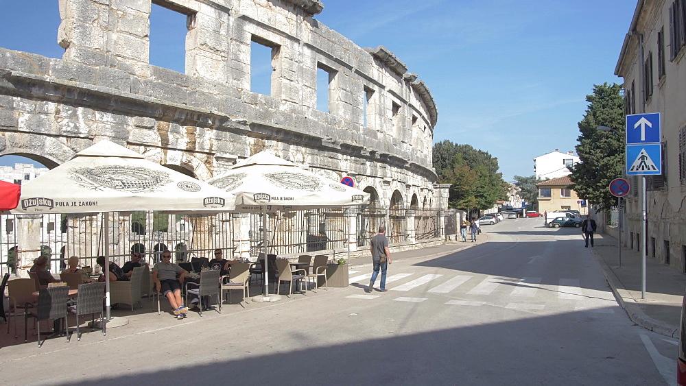 Cafe and the Amphitheatre against blue sky, Pula, Istria County, Croatia, Adriatic, Europe