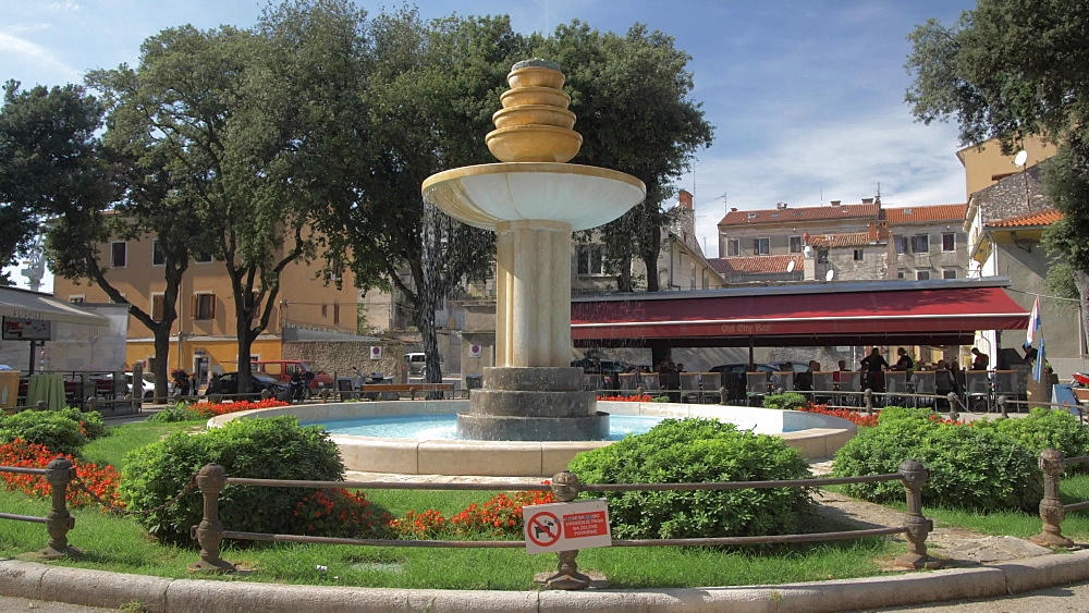 Cafes and water fountain in Dante Square in old town, Pula, Istria County, Croatia, Adriatic, Europe