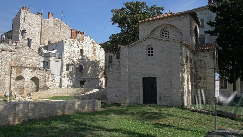 Roman ruins and church in old town, Pula, Istria County, Croatia, Adriatic, Europe