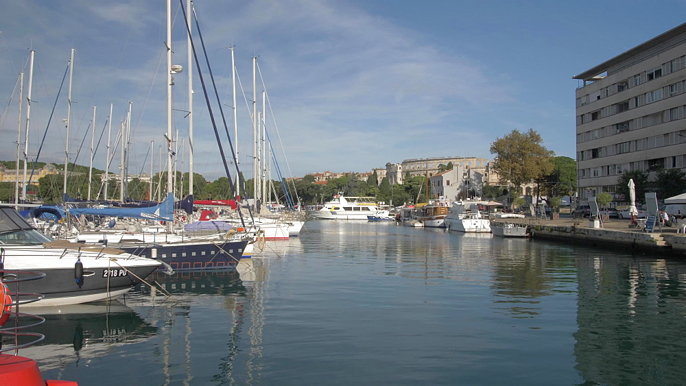 Harbour boats and the Amphitheatre against blue sky, Pula, Istria County, Croatia, Adriatic, Europe
