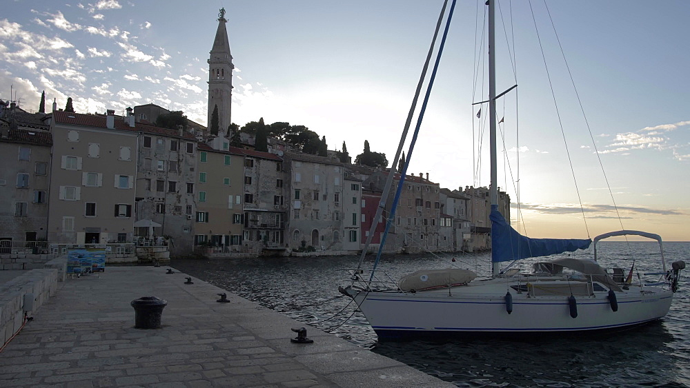 Harbour boats, Adriatic Sea and the old town at sunset, Rovinj, Istria County, Croatia, Europe