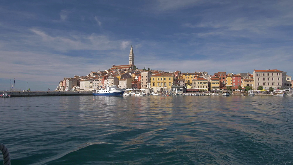 Onboard boat shot of Cathedral of St. Euphemia and the old town on sunny day, Rovinj, Istria County, Croatia, Europe