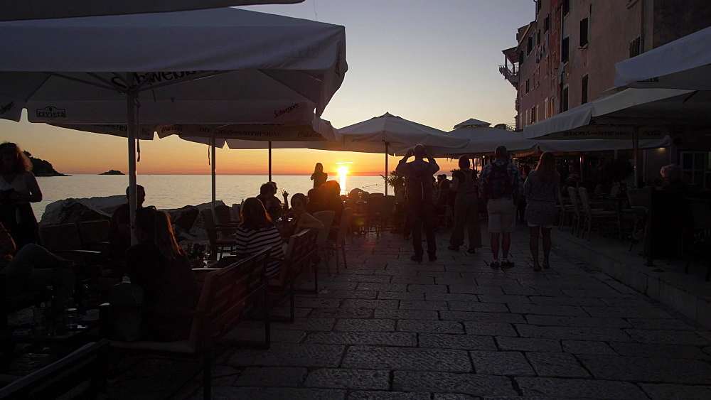 Adriatic Sea and restaurants in the old town at sunset, Rovinj, Istria County, Croatia, Europe