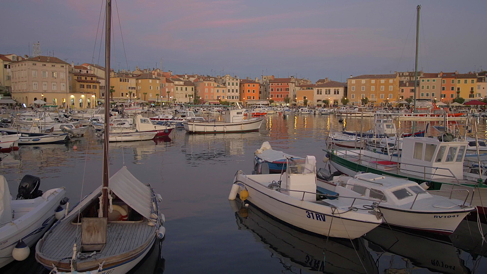 Crane shot of harbour in the old town at dusk, Rovinj, Istria County, Croatia, Europe