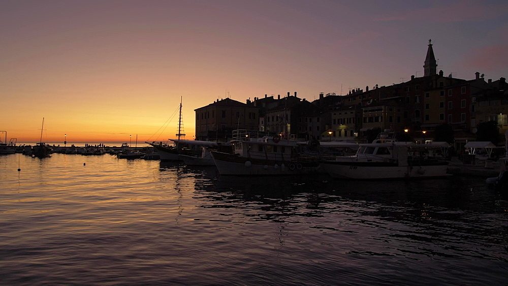 Harbour and Cathedral of St. Euphemia in the old town at dusk, Rovinj, Istria County, Croatia, Europe