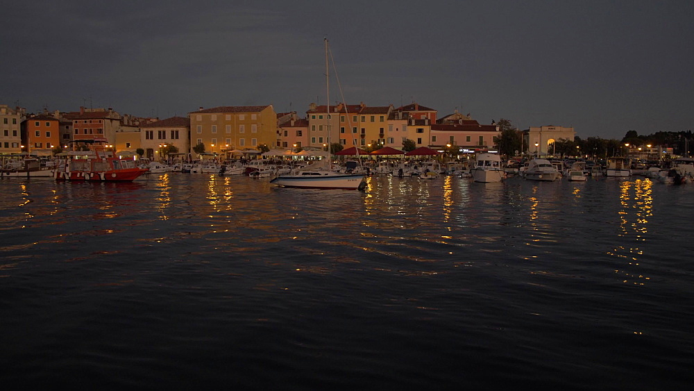 Pan shot of harbour in the old town at dusk, Rovinj, Istria County, Croatia, Europe