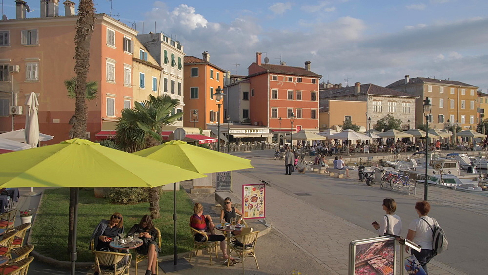 Harbour cafe and Cathedral of St. Euphemia in the old town, Rovinj, Istria County, Croatia, Europe