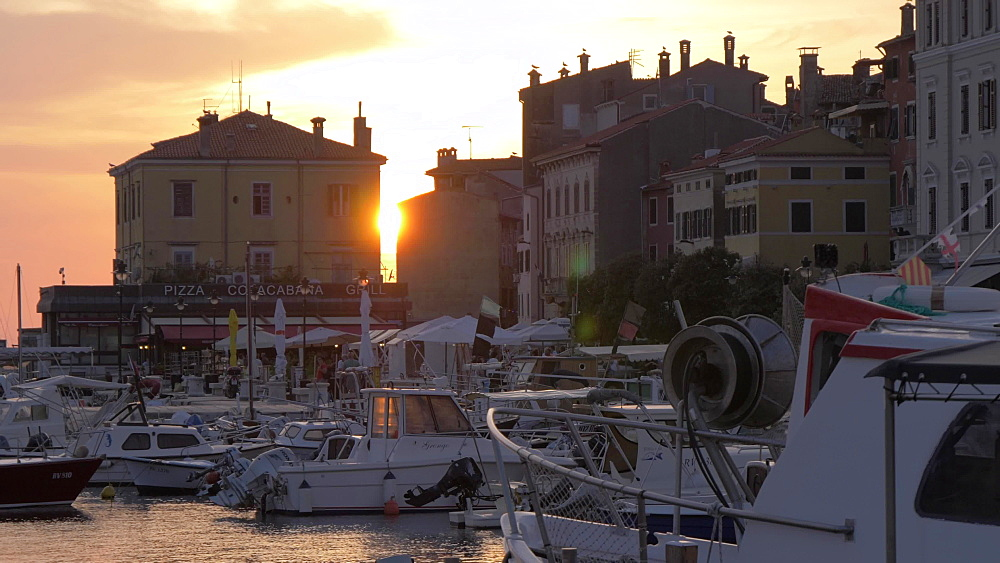 Harbour and boats in the old town at sunset, Rovinj, Istria County, Croatia, Europe