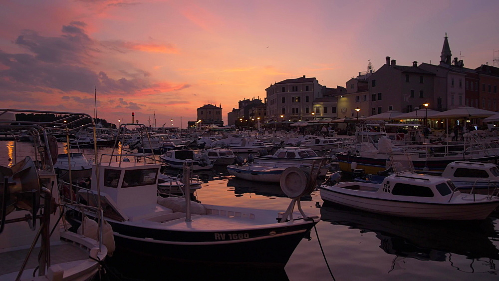 Pan shot of cafes, restaurants and cathedral of St. Euphemia in the old town at dusk, Rovinj, Istria County, Croatia, Europe