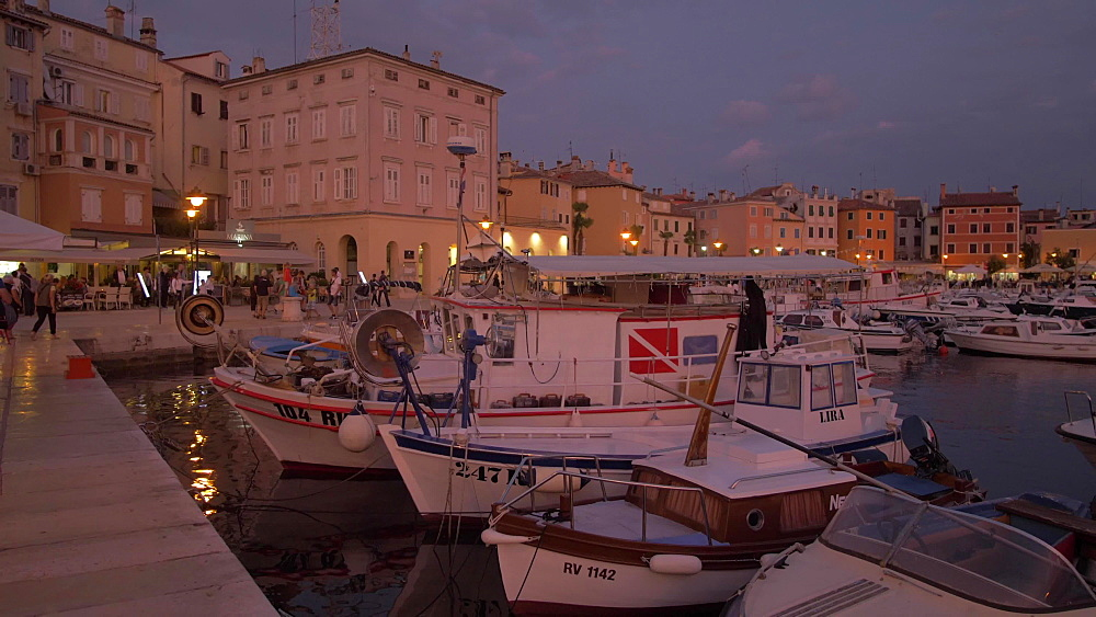 Cafes and restaurants in the old town at dusk, Rovinj, Istria County, Croatia, Europe