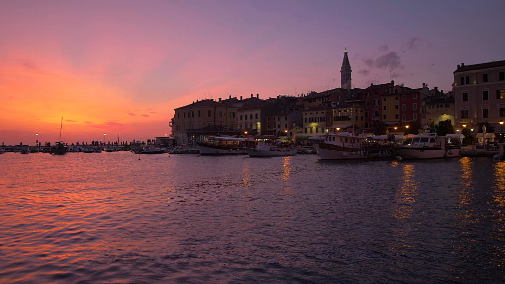 Pan shot of cafes and restaurants in the old town at dusk, Rovinj, Istria County, Croatia, Europe