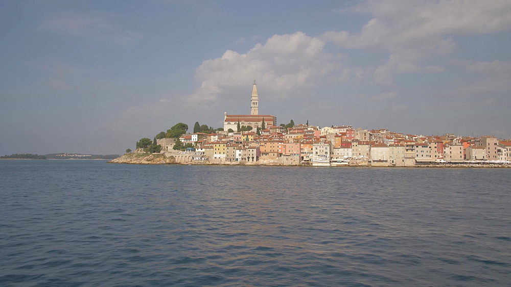 On board boat shot approaching harbour and Cathedral of St. Euphemia, Rovinj, Istria County, Croatia, Europe