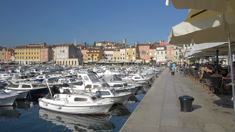 Harbour boats and harbourside cafes, Rovinj, Istria County, Croatia, Europe