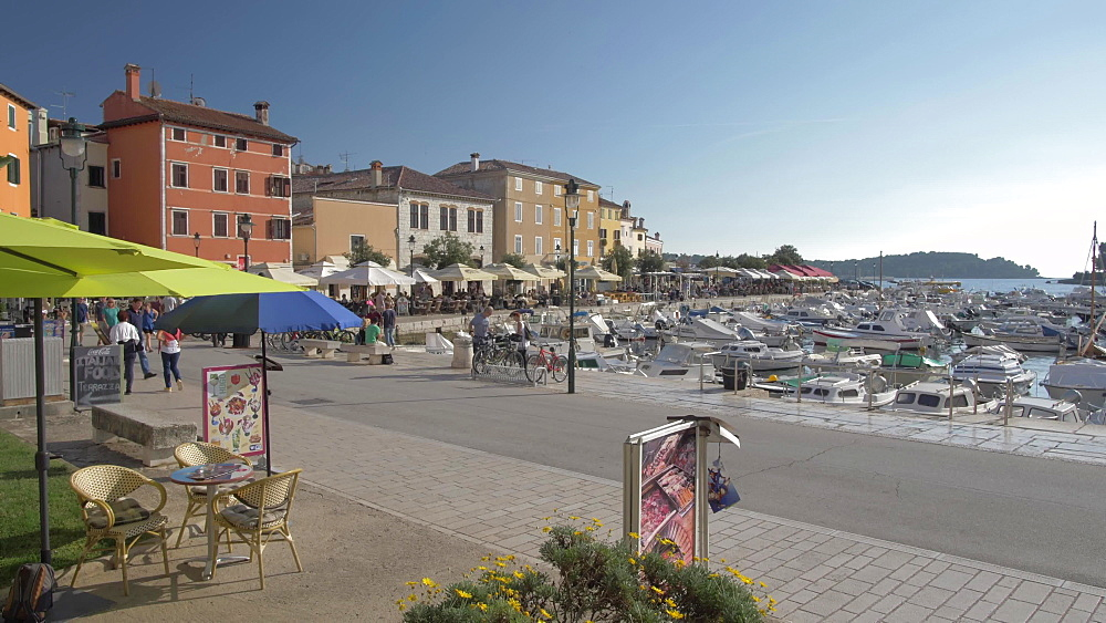 Harbour boats and harbour side cafes, Rovinj, Istria County, Croatia, Europe