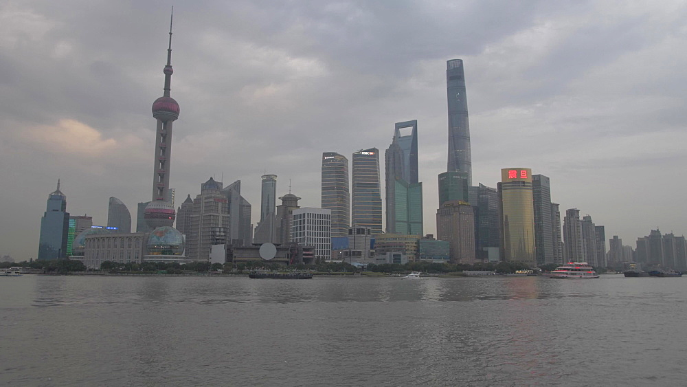 Pudong Skyline and Huangpu River from the Bund at dusk, Shanghai, People's Republic of China, Asia