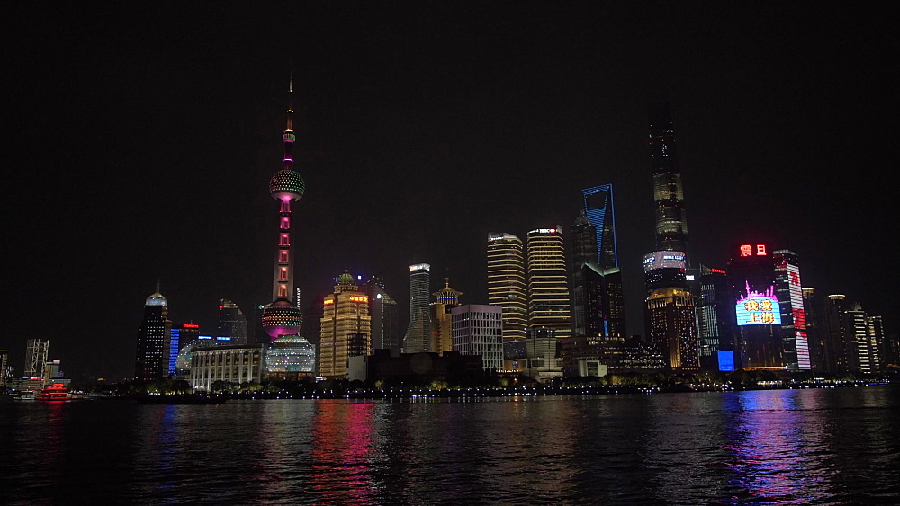 Pudong Skyline and Huangpu River from the Bund at night, Shanghai, People's Republic of China, Asia