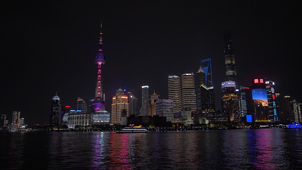 Pan shot of Pudong Skyline and Huangpu River from the Bund at night, Shanghai, People?s Republic of China, Asia